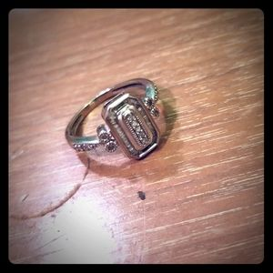 Silver ring with small diamonds